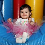 Aubrey's First Birthday Party Photos! On one of the inflatables!